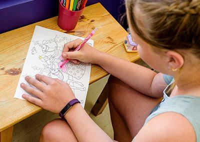 girl drawing princess at dentist for kids