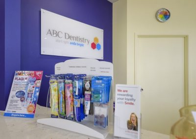 abc dentistry for children maroochydore signage and tooth brushes on the kids dentist reception desk
